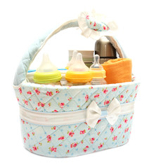 diapers milk bottle and flask in basket isolated on white backgr