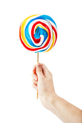 Hand holding lollipop isolated on white background
