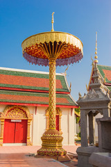 Golden tiered umbrella in temple, Thailand.