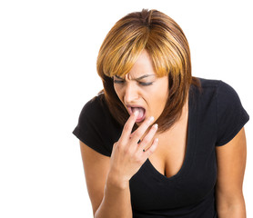 Young woman sticking finger in her throat, about to vomit