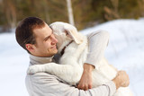Winter Labrador retriever with owner