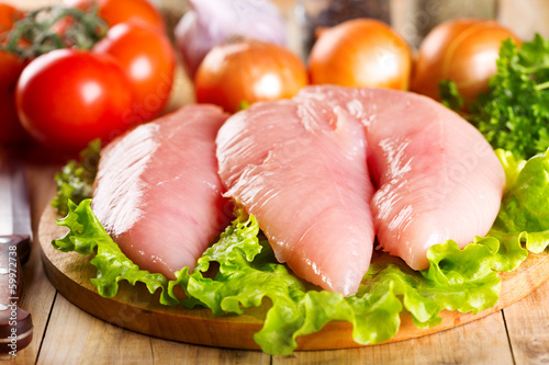 Raw chicken breast with vegetables