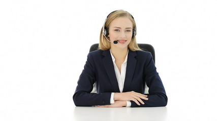 Happy, smiling young beautiful business woman at call center.