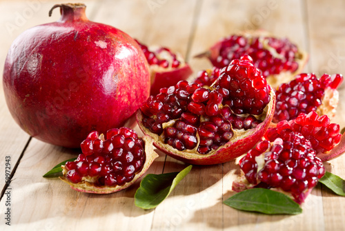 pomegranate with leafs - 59972943