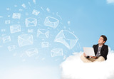 Businessman sitting in cloud with laptop