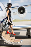 Wealthy Woman Disembarking Private Jet poster