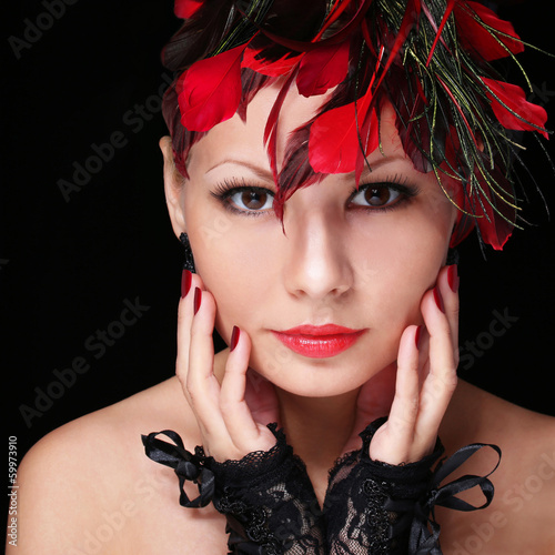 Fashion girl with feathers. Young woman with red lipstick