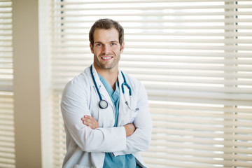 Confident Cancer Specialist With Arms Crossed At Clinic