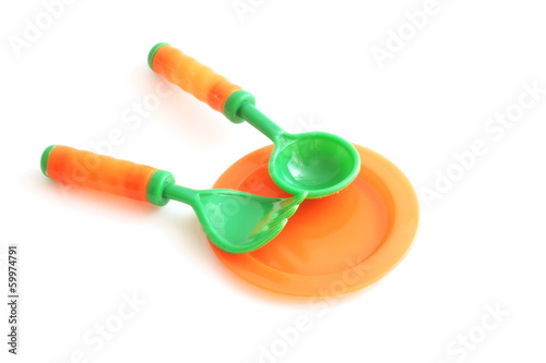 plastic tableware toys on white background