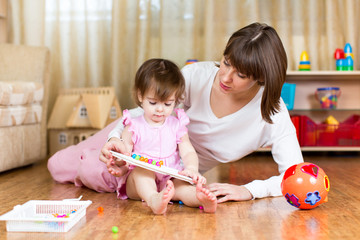 cute mother and kid girl play together