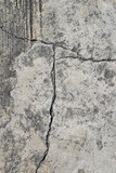 Cracked concrete texture closeup background.