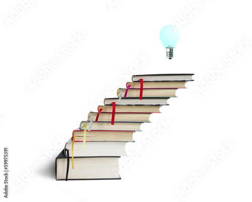 Stack of books with lamp on the top