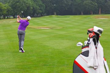Golfer fairway iron shot