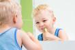 child boy brushing teeth in bathroom