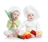 kids boy and girl wearing a chef hat with healthy  food vegetabl