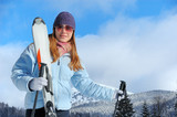 Young woman with ski