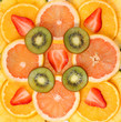 Sliced Fruits Background. Strawberry, Kiwi, Pineapple, Grapefrui