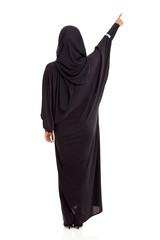 rear view of Muslim woman pointing up
