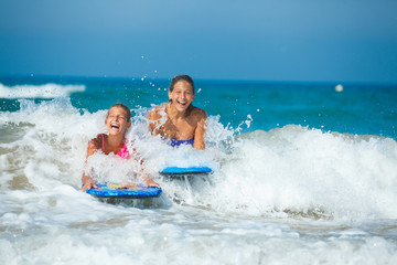 Summer vacation - surfer girls.