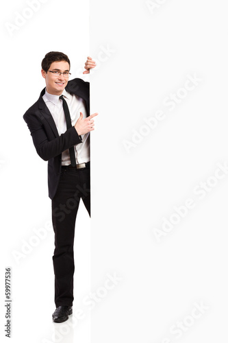 Businessman pointing at white banner.