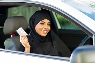 muslim woman showing a driving license