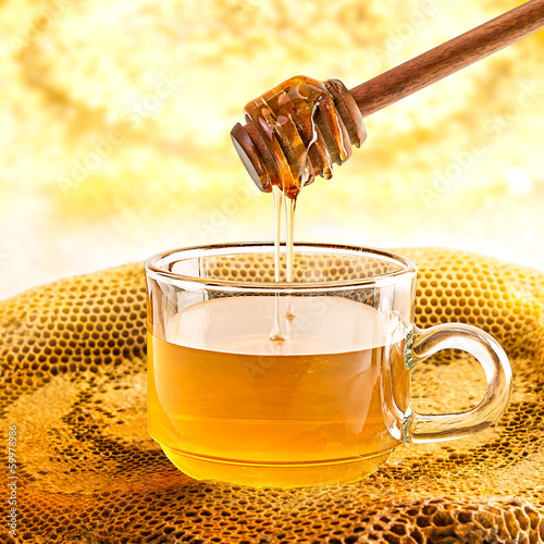 Glass of honey and honeycomb