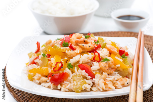 Chinese food - white rice with vegetables and shrimps on a plate