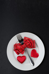 Festive table setting for Valentine's Day on black background