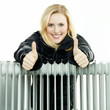 Woman with radiator shows thumbs up