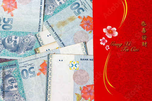 Chinese new year money packet with Malaysian RM50 notes.