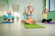 Group of woman are doing yoga exercises