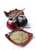 yerba mate and calabashes on a light wooden background