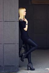 Beautiful blonde girl in city