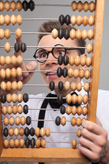 Nerd with abacus.