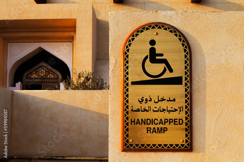 Disabled plaque in Arabic and English at entrance to the Mosque