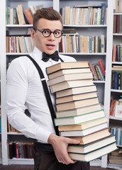 Carrying a book stack.