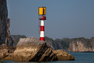 Lighthouse on the rock at Ha long Bay in North Vietnam