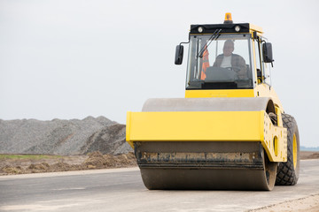 Road compactor during asphalt pavement works