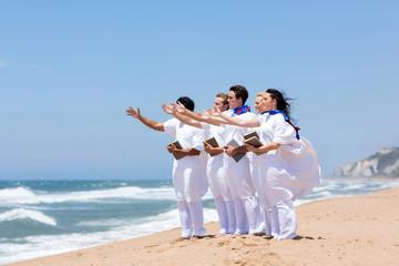 young church choir singing on the beach