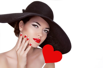 Valentine's Day. Beautiful woman with heart in her hand wearing