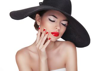 Beauty portrait of beautiful fashion woman with black hat, profe