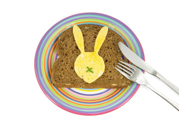 plate with slice of bread and Easter Bunny egg on it