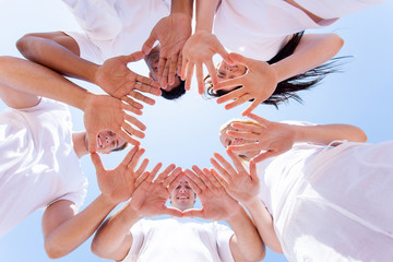 underneath view of people hands together
