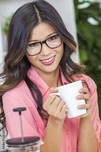 Asian Chinese Woman Girl in Kitchen Drinking Coffee