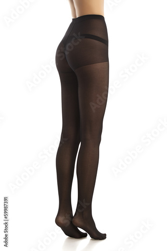 girl in black pantyhose. Isolated. White background.
