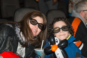 Single mother and son enjoying at the cinema