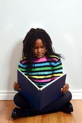 little black girl reading book