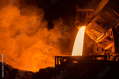 canvas print picture Hot steel pouring in steel plant