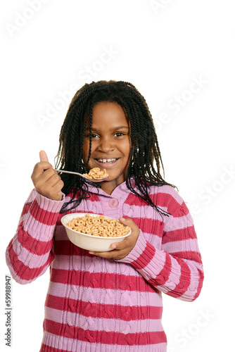 little black girl enjoying bowl of cereal