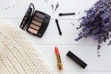 Eyeshadow, brushes and lipstick in autumn / winter colors